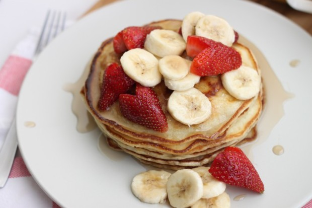 Buttermilk Pancakes with strawberries, bananas and maple syrup!